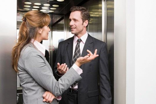 Colleagues having discussion --- Image by © Image Source/Corbis